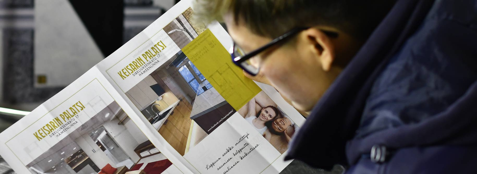 Picture of man viewing apartment advert