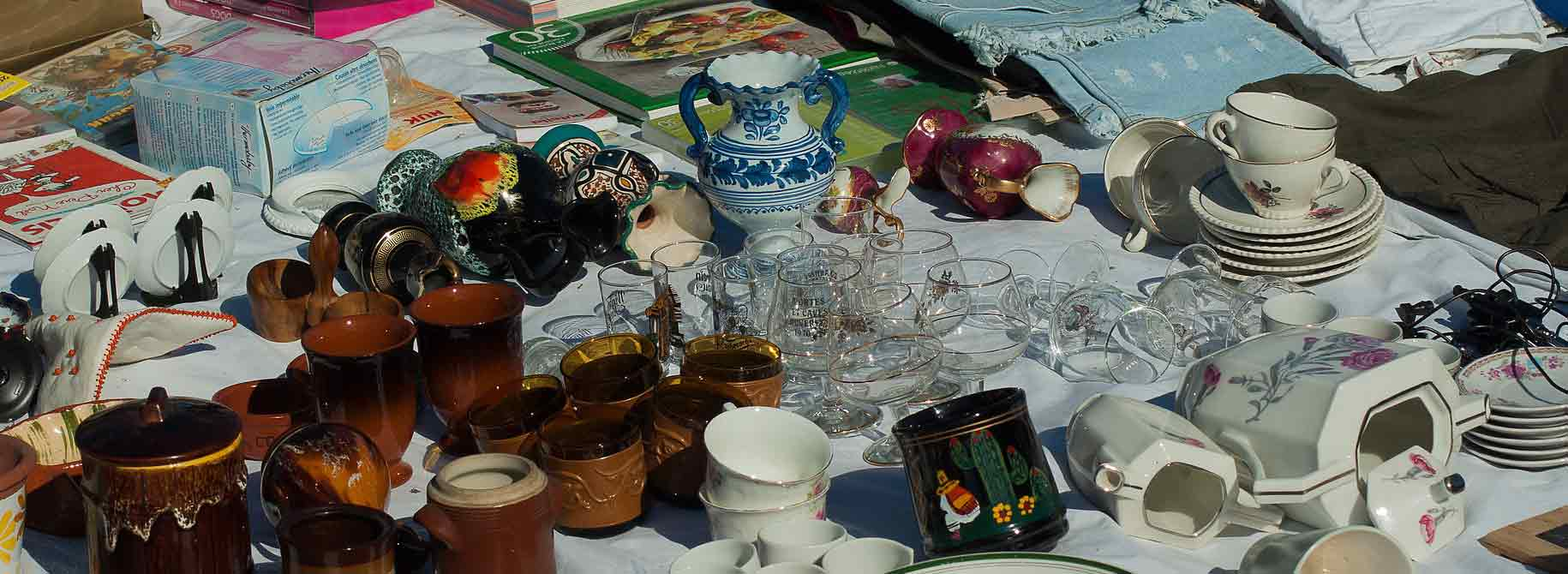 picture of a flea market table with collection of things