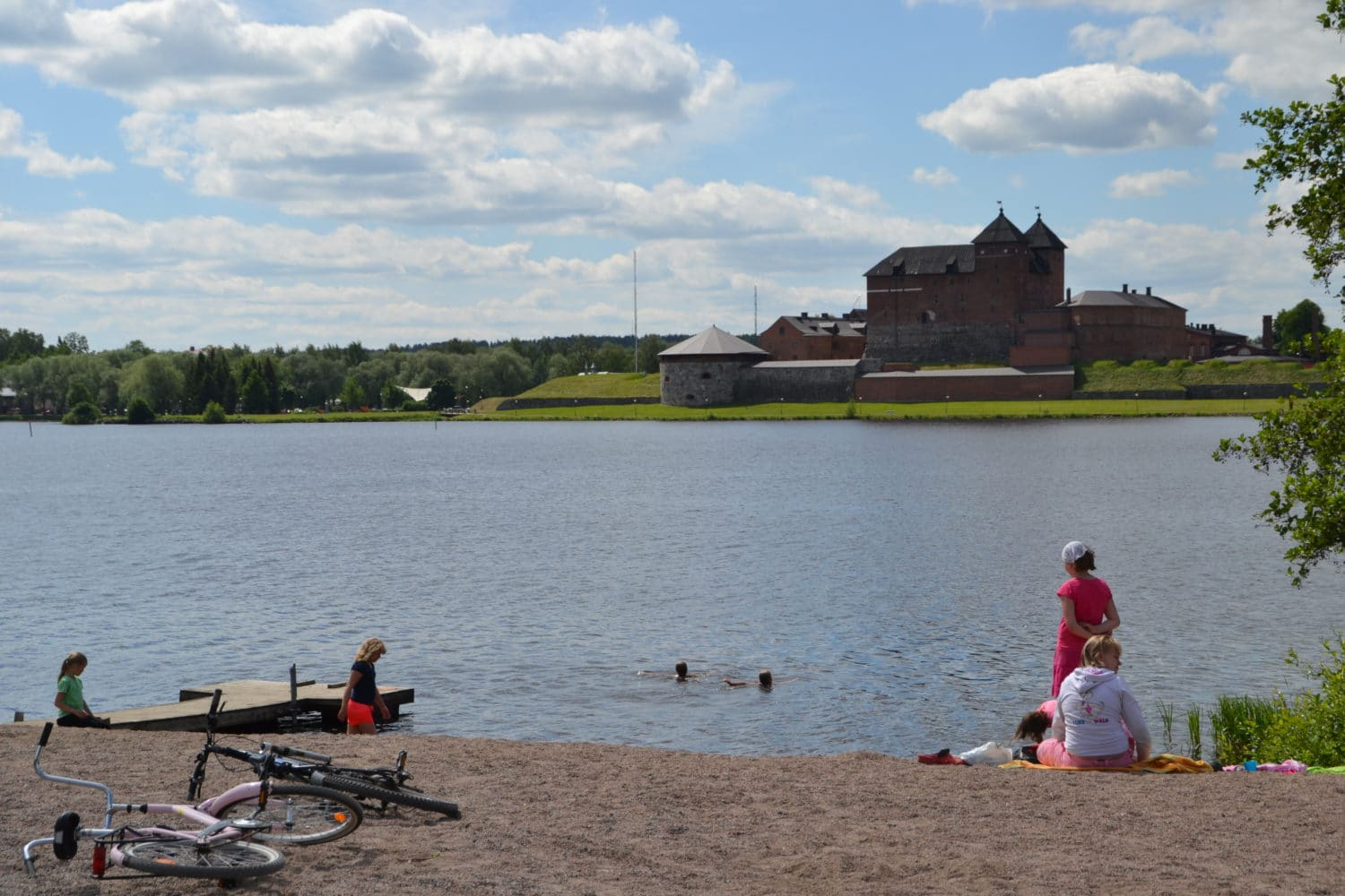 picture of beach with Häme castle in the background