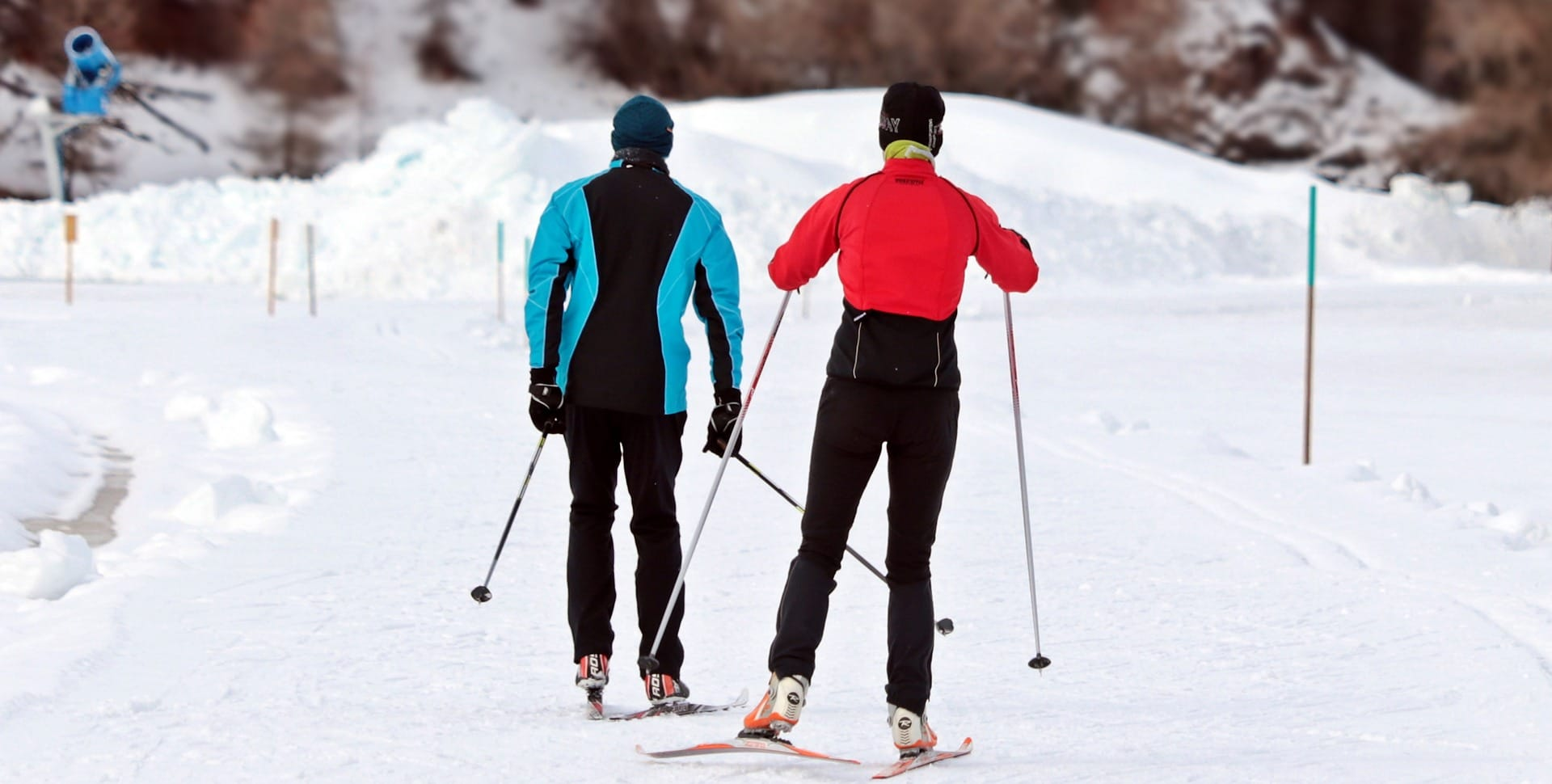 two skiers on track