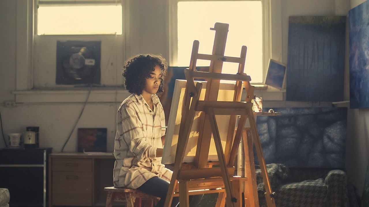 woman painting board