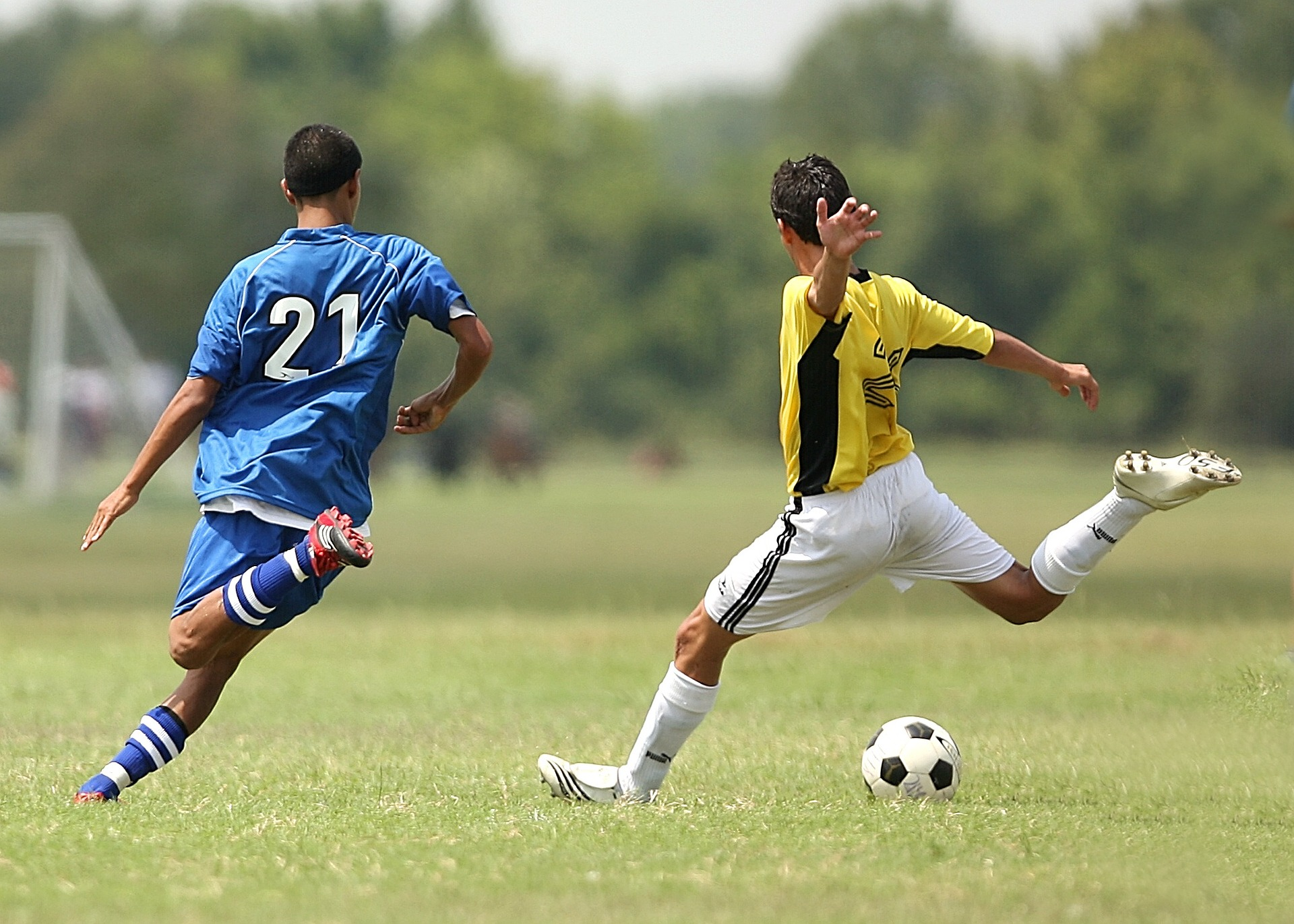 two men play football