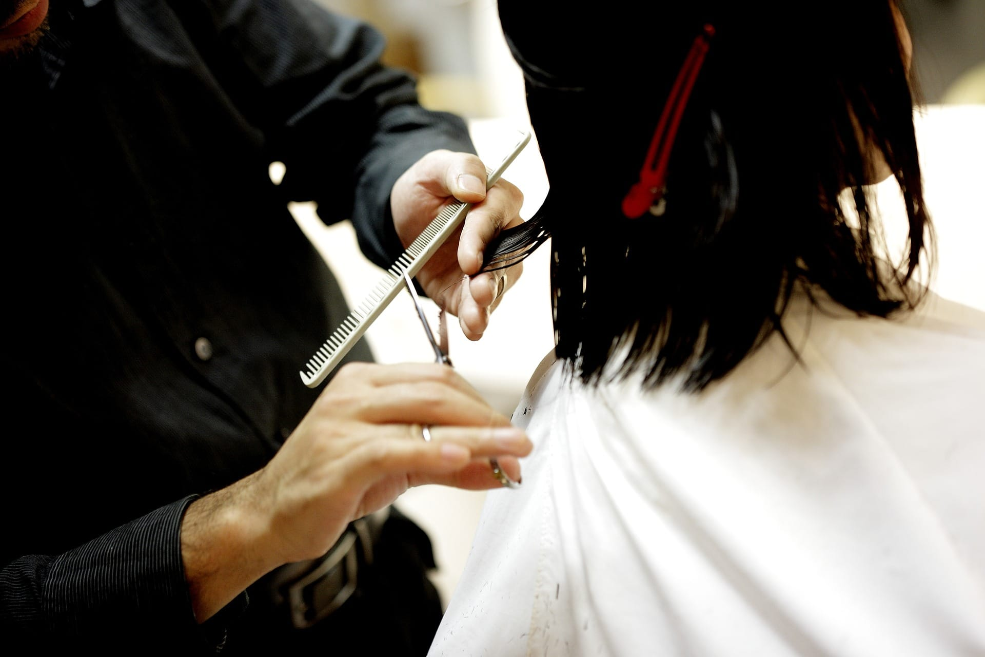 A hairdresser cutting hair