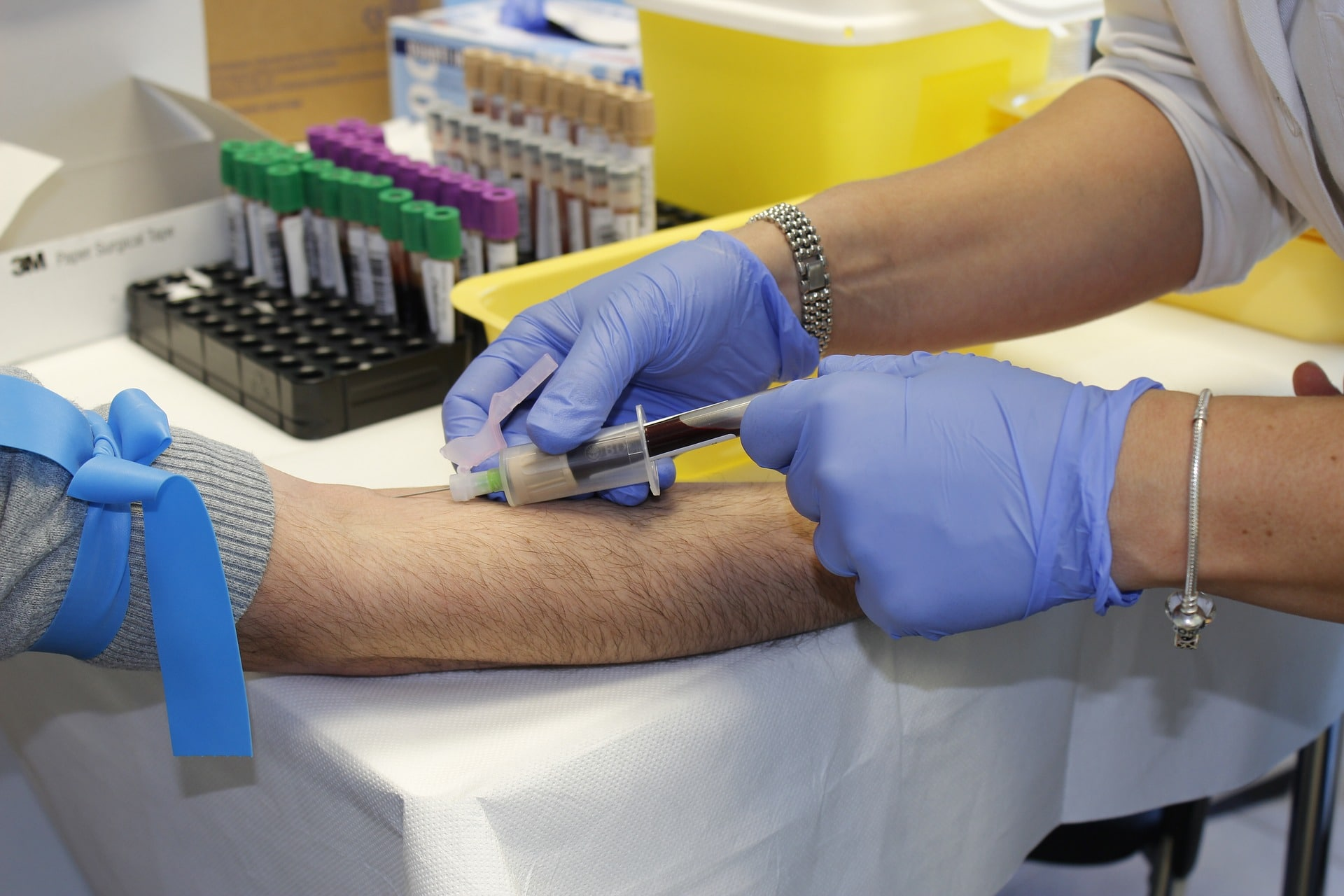 a nurse taking a blood sample